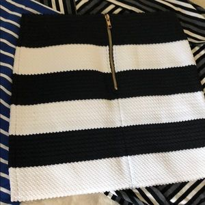 Cute tight short black and white striped skirt
